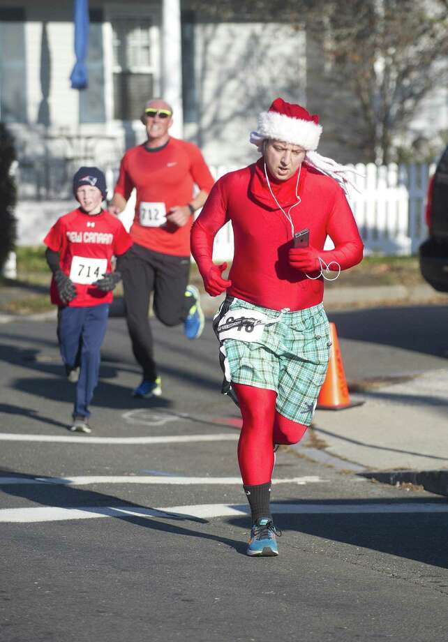As part of its 2017 Hospital for Special Surgery Greenwich Cup, Threads and Treads invites festively clad runners, walkers and joggers to participate in the shop's 30th Annual William Raveis Jingle Bell Jog Sunday in downtown Greenwich. Find out more.  Photo: Lindsay Perry / Lindsay Perry/for Hearst Connect / Greenwich Time Freelance