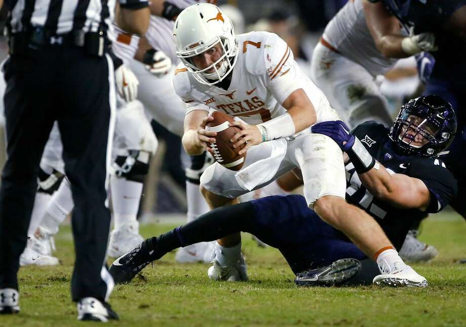 Texas quarterback Shane Buechele is sacked by TCU linebacker Ty Summers during a Nov. 4, 2017 game in Fort Worth, Texas. TCU won 24-7. Photo: Ron Jenkins /AP Photo