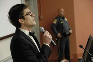 """In this Nov. 28, 2017 photo, Lucian Wintrich, White House correspondent for the right-wing blog Gateway Pundit, speaks at the University of Connecticut in Storrs, Conn. The conservative commentator was arrested and charged with breach of peace after an altercation during his speech titled """"It's OK To Be White."""""""