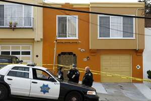 Police officers guard 16 Howth St. in S.F.'s Ingleside neighborhood, the house where five people were brutally bludgeoned to death in 2012.