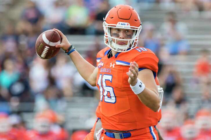 Sam Houston State's Jeremiah Briscoe attempts a pass in the first half of an NCAA college football game Saturday, Nov. 4, 2017, in Huntsville, Texas. (AP Photo/Joe Buvid)