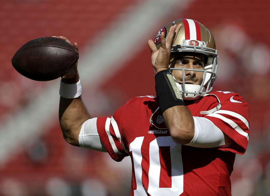 In this Nov. 5, 2017, file photo, San Francisco 49ers quarterback Jimmy Garoppolo (10) warms up before an NFL football game against the Arizona Cardinals in Santa Clara, Calif. The way Garoppolo plays down the stretch once he finally takes over as the starting quarterback for the 49ers will determine how much money he will get paid to be the franchise quarterback in San Francisco. (AP Photo/Marcio Jose Sanchez, File) Photo: Marcio Jose Sanchez, Associated Press