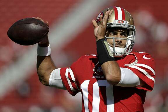 FILE - In this Nov. 5, 2017, file photo, San Francisco 49ers quarterback Jimmy Garoppolo (10) warms up before an NFL football game against the Arizona Cardinals in Santa Clara, Calif. The way Garoppolo plays down the stretch once he finally takes over as the starting quarterback for the 49ers will determine how much money he will get paid to be the franchise quarterback in San Francisco. (AP Photo/Marcio Jose Sanchez, File)