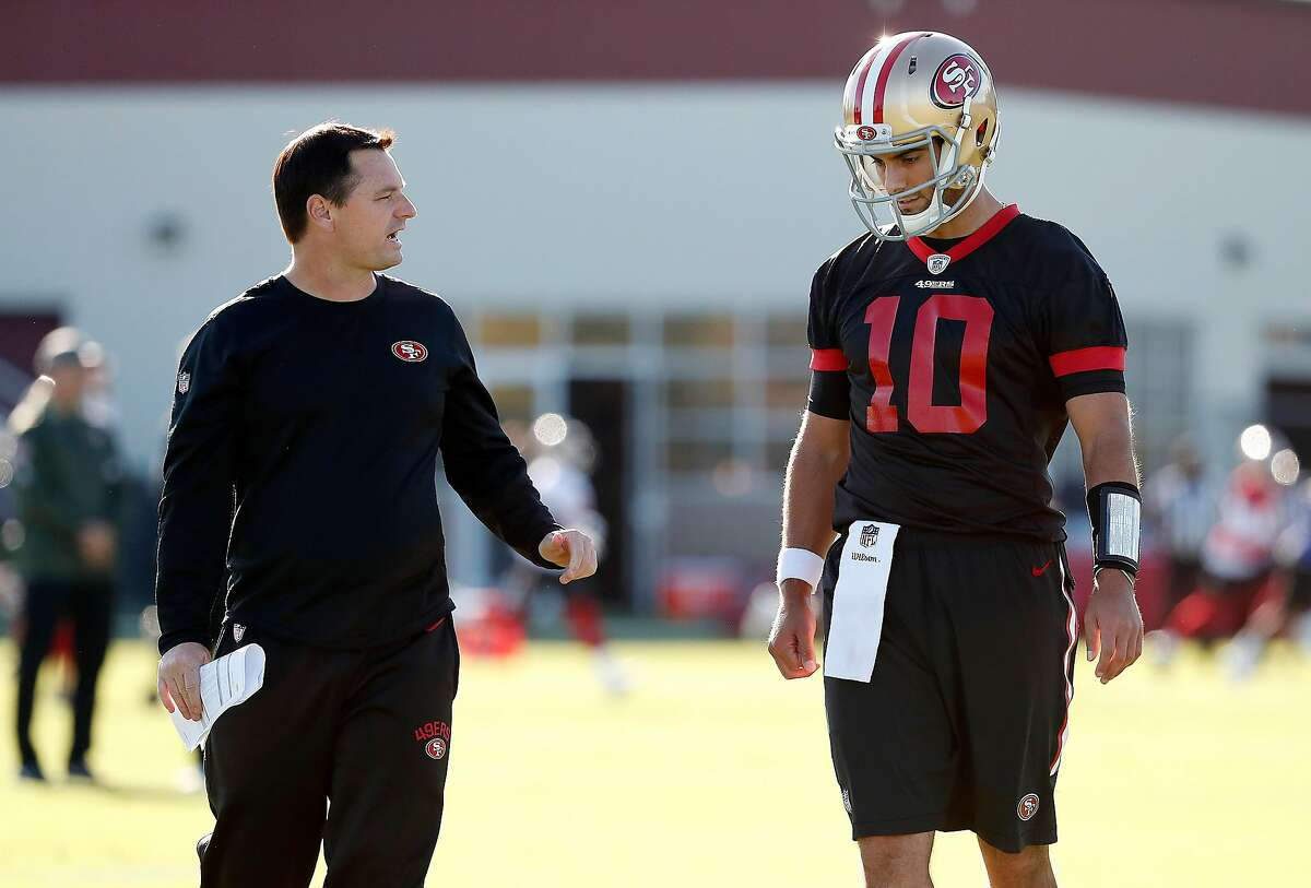 San Francisco 49ers quarterback Jimmy Garoppolo talks with quarterbacks coach Rich Scangarello, left, during a practice at the team's NFL training facility in Santa Clara, Calif., Wednesday, Nov. 29, 2017. The Niners announced Garoppolo is set to make his first start on the road this week against the Chicago Bears.