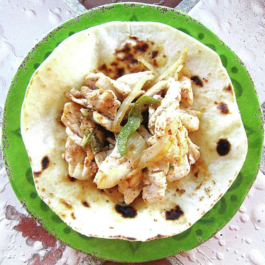 Chicken fajita taco on a handmade flour tortilla from Blanquita's Mexican Restaurant. Photo: Mike Sutter /San Antonio Express-News