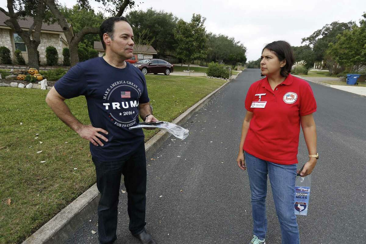 Bexar County GOP Chairman Robert Stovall (left) and Communication Committee Chair Laura Koerner pause to chat while block walking in the Fair Oaks Ranch communities on Saturday, Nov. 5, 2016. In the last push before Tuesday's election, about 15-20 volunteers went home to home to encourage their Republican base to head to the polls to vote in the presidential elections along with several local races especially the 23rd District congressional race between Republican incumbent Will Hurd and Democrat opponent Pete Gallego. (Kin Man Hui/San Antonio Express-News)
