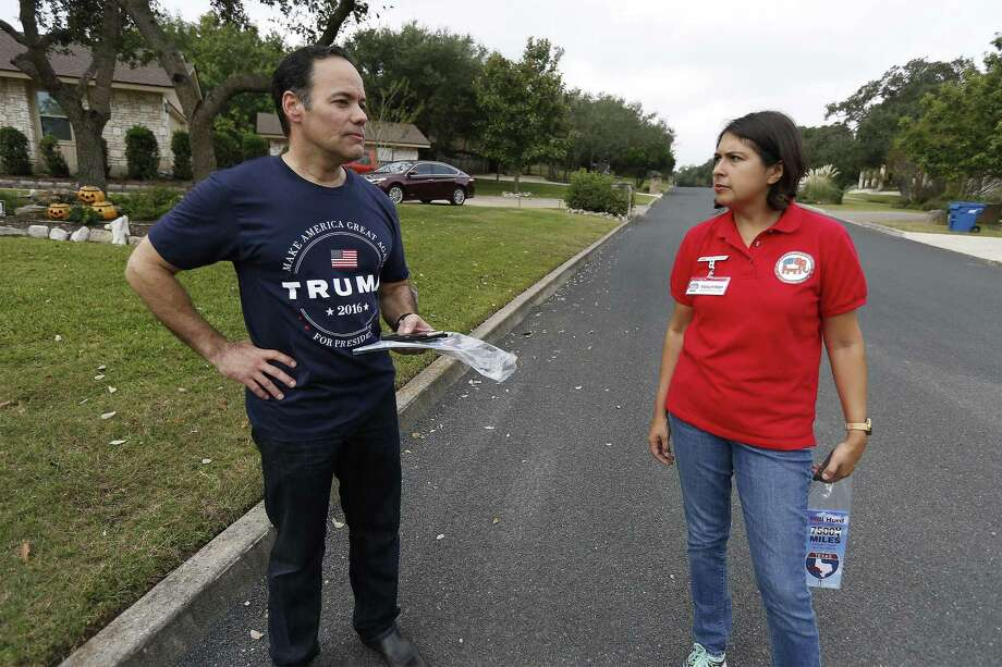 Bexar County GOP Chairman Robert Stovall (left) and Communication Committee Chair Laura Koerner pause to chat while block walking in the Fair Oaks Ranch communities on Saturday, Nov. 5, 2016. In the last push before Tuesday's election, about 15-20 volunteers went home to home to encourage their Republican base to head to the polls to vote in the presidential elections along with several local races especially the 23rd District congressional race between Republican incumbent Will Hurd and Democrat opponent Pete Gallego. (Kin Man Hui/San Antonio Express-News) Photo: Kin Man Hui, Staff / San Antonio Express-News / ©2016 San Antonio Express-News