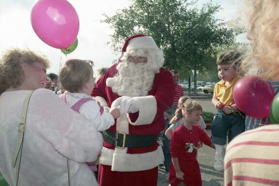 11/25/1988 - Santa Claus greets early holiday shoppers outside Foley's at Memorial City Shopping Center the Friday after Thanksgiving.
