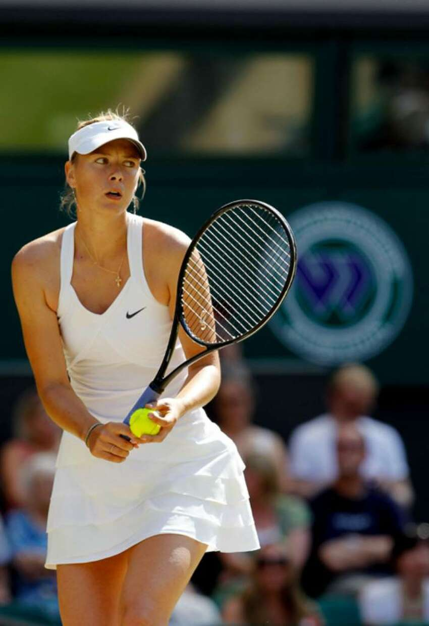 Maria Sharapova of Russia in action during her match against Serena Williams of USA on Day Seven of the Wimbledon Lawn Tennis Championships at the All England Lawn Tennis and Croquet Club on June 28, 2010 in London, England.