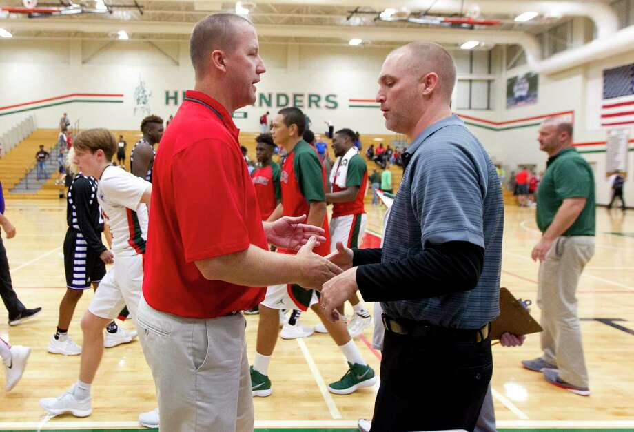 Willis head coach Michael Storms, right, shakes hands with The Woodlands head coach Dale Reed after a high school boys basketball game at The Woodlands High School, Tuesday, Nov. 28, 2017, in The Woodlands. Photo: Jason Fochtman, Staff Photographer / © 2017 Houston Chronicle