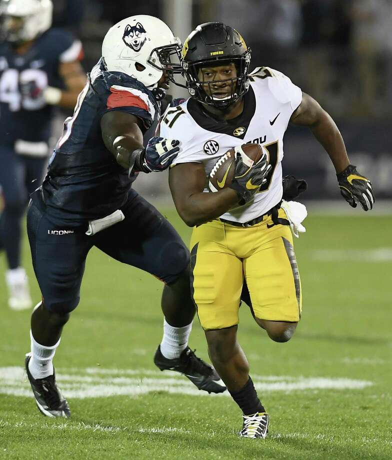 Missouri running back Ish Witter, right, is pursued by Connecticut linebacker Junior Joseph, left, during the first half of an NCAA college football game, Saturday, Oct. 28, 2017, in East Hartford, Conn. (AP Photo/Jessica Hill) Photo: Jessica Hill / Associated Press / AP2017