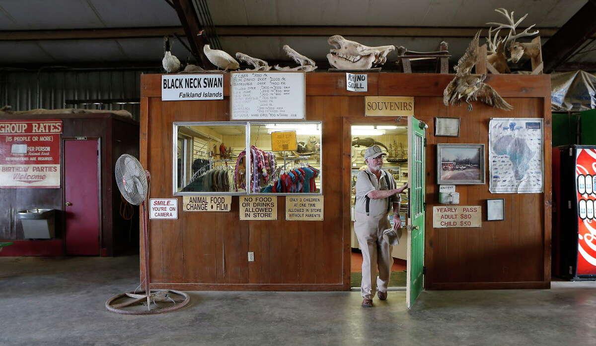 Clint Wolston, owner of Bayou Wildlife Zoo, exits his souvenir shop Wednesday, Nov. 29, 2017, in Galveston County.