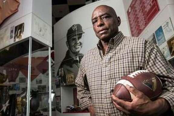 Former University of Houston running back Warren McVea poses for a portrait in the University of Houston Hall of Fame on Sept. 9, 2015, in Houston.