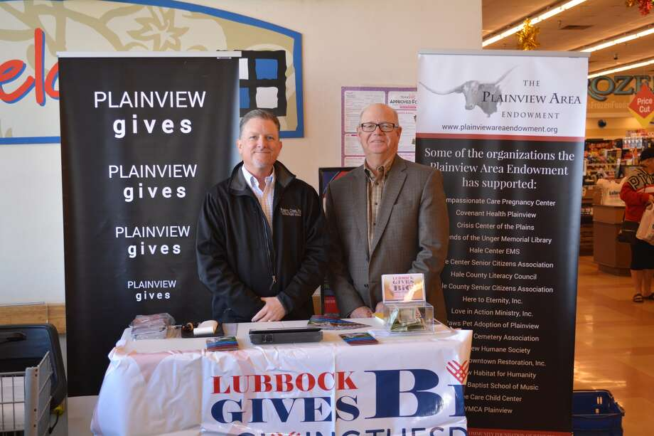 Plainview Area Endowment board members Bill Cross and Mike Fox man the PAE's #GivingTuesday booth Tuesday afternoon at the Olton Road United Supermarket. #Giving Tuesday is a worldwide event that started in 2012. This is the second year that PAE has participated in the event. Photo: William Carroll, Plainview Herald