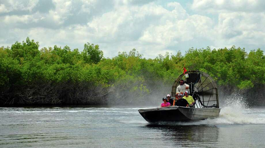 Airboats skim over the Florida Everglades, a vast wetland flowing from Lake Okeechobee south to the tip of Florida's mainland. Only a fifth lies within the national park where airboats are banned. Photo: Katherine Rodeghier /TNS / Chicago Tribune