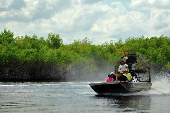 Airboats skim over the Florida Everglades, a vast wetland flowing from Lake Okeechobee south to the tip of Florida's mainland. Only a fifth lies within the national park where airboats are banned.