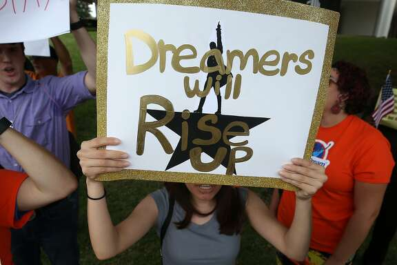 """People with United We Dream Houston rally outside Senator John Cornyn's office to voice their support for a """"Dream Act"""" without dangerous enforcement add-ons Thursday, Oct. 5, 2017, in Houston. ( Godofredo A. Vasquez / Houston Chronicle )"""