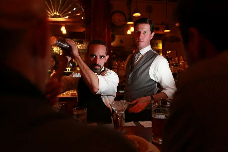 Comstock saloon keeper Jonny Raglin (right) and bartender Matty Conway (left) have a shot as they take a break in San Francisco , Calif., on Friday, December 3, 2010.