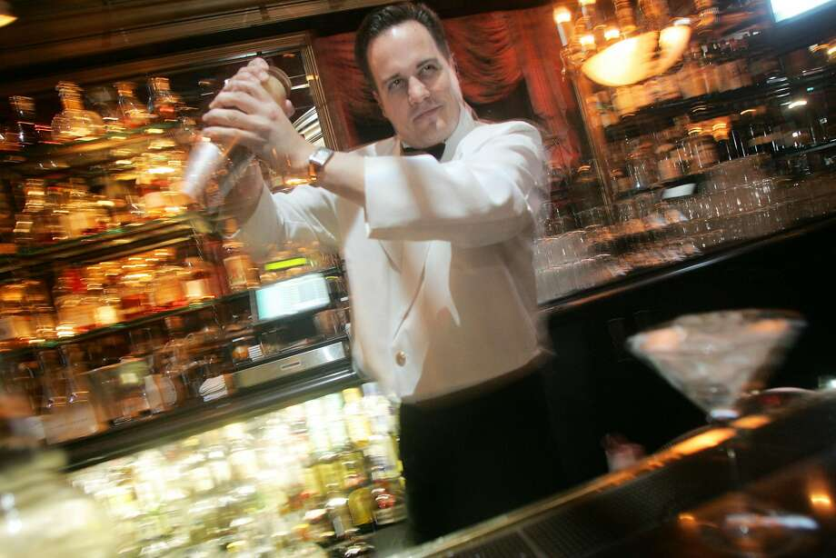 Marcovaldo Dionysos, a San Francisco cocktail pioneer, behind the bar at Harry Denton's Starlight Room in S.F. in 2006. Photo: MIKE KEPKA, The San Francisco Chronicle