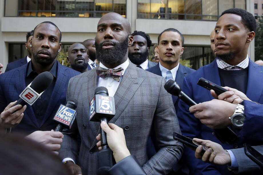 In this   Oct. 17  photo, former 49ers wide receiver Anquan Boldin (left), Philadelphia Eagles safety Malcolm Jenkins and 49ers safety Eric Reid speak to reporters outside NFL headquarters after meetings in New York. Photo: Richard Drew, Associated Press