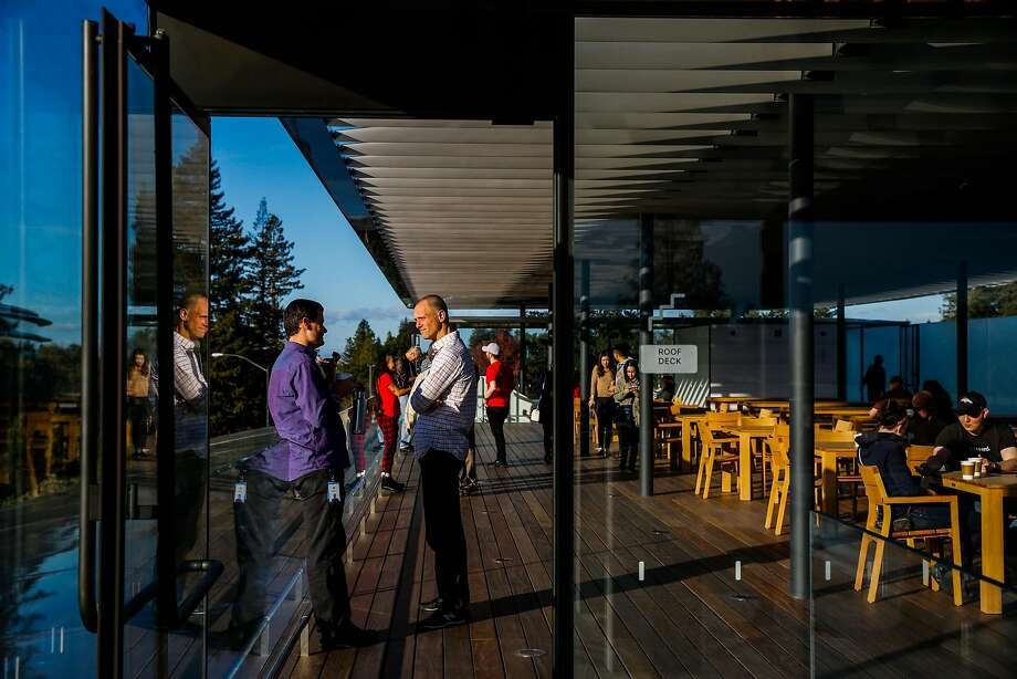 Visitors relax on the terrace at the Apple visitors center. Photo: Gabrielle Lurie, The Chronicle