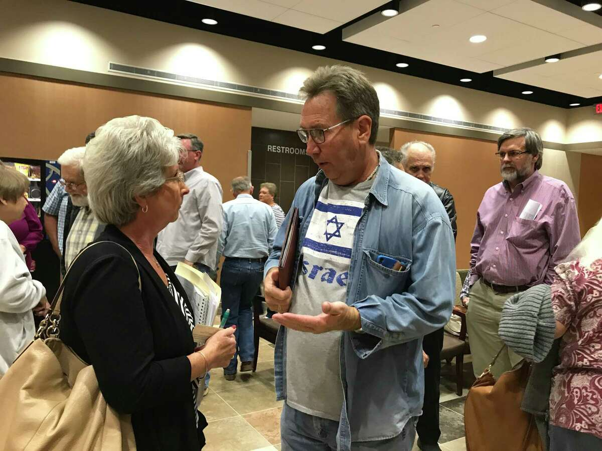 Michele Falzon, who is among residents suing the city of Pearland to stop annexation of their land, speaks with another resident at a Nov. 27 Pearland City Council meeting. The council voted to annex her land and other tracts but a court order blocked it from taking action on another parcel.