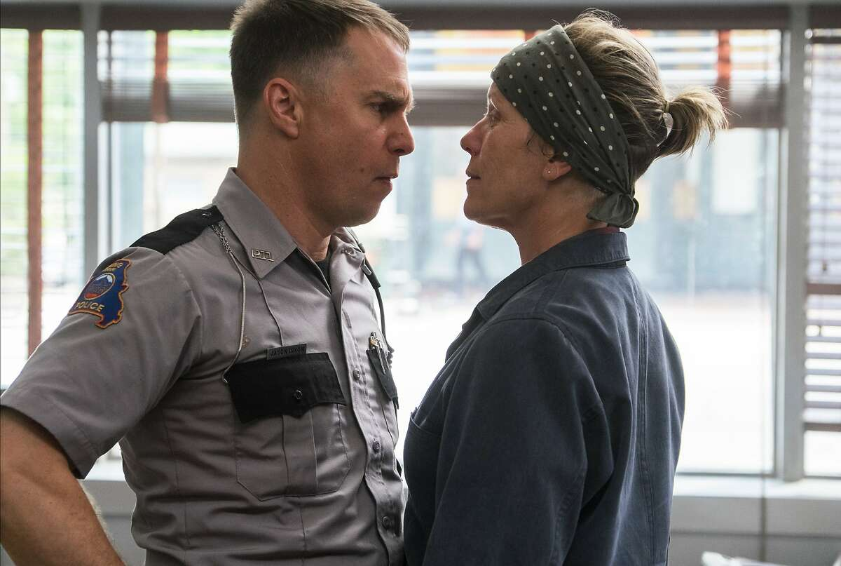 This image released by Fox Searchlight shows Sam Rockwell, left, and Frances McDormand in a scene from