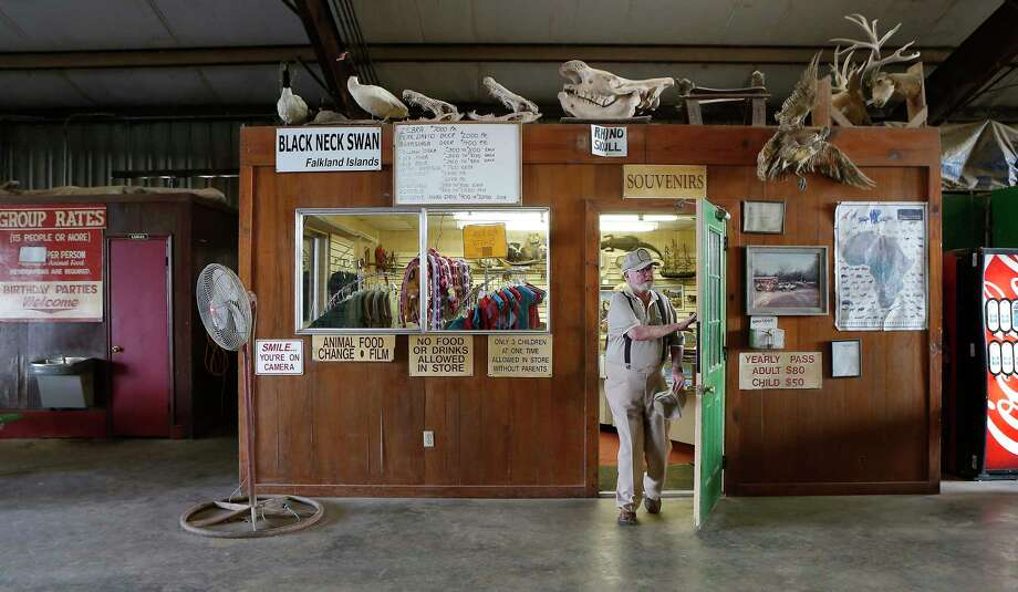 Clint Wolston, owner of Bayou Wildlife Zoo, exits his souvenir shop Wednesday, Nov. 29, 2017, in Galveston County.