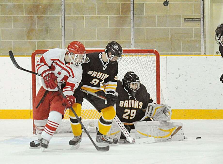 Brunswick goalie Dan Dachille (29), right, makes a stop on a shot by Hoosac's Andrew Lisignan (8), left, as Ryan Carmichael (9), also of Brunswick, defends during the boys high school ice hockey game between Brunswick School and Hoosac School at Brunswick in Greenwich, Conn., Saturday afternoon, Jan. 14, 2017. Photo: Bob Luckey Jr. / Hearst Connecticut Media / Greenwich Time