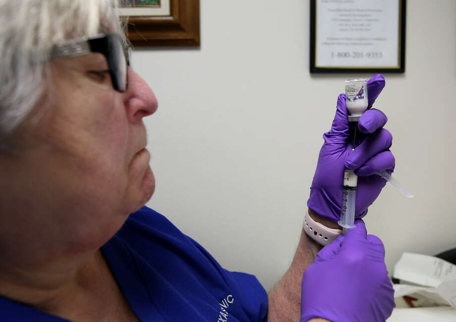 The Texas Clinic nurse and drug counselor Gloria Rodriguez prepares a Vivitrol injection Wednesday, Nov. 29, 2017, in Houston. Photo: Godofredo Vasquez