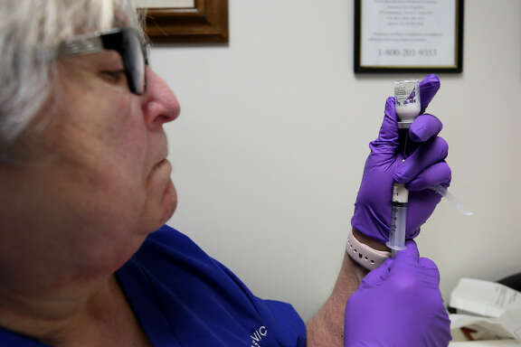 The Texas Clinic nurse and drug counselor Gloria Rodriguez prepares a Vivitrol injection Wednesday, Nov. 29, 2017, in Houston.