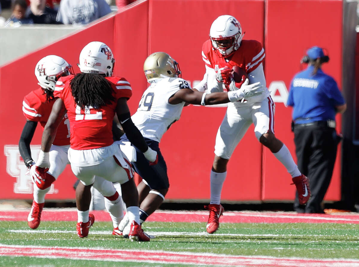 Houston Cougars cornerback Alexander Myres (18) catches an interception over Navy Midshipmen running back Darryl Bonner (29) in the second half of a college football game at TDECU Stadium, Friday, Nov. 24, 2017, in Houston. ( Karen Warren / Houston Chronicle )
