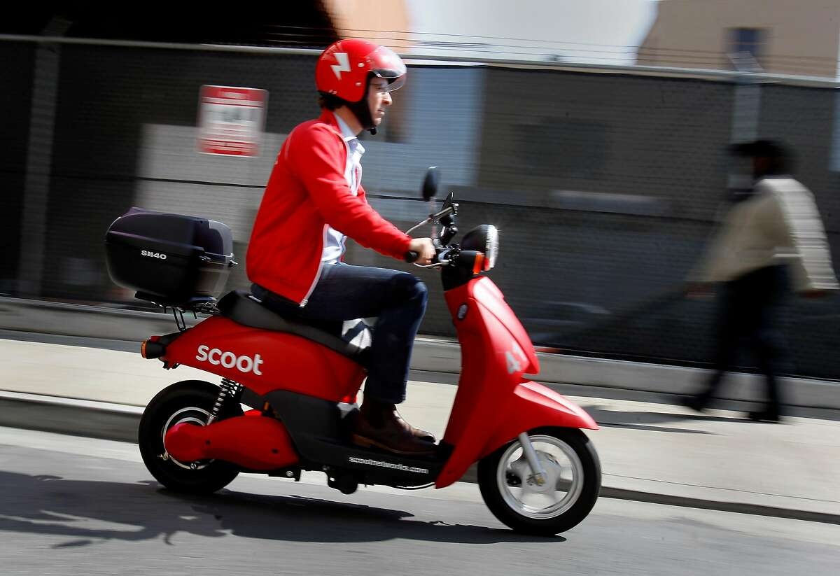 Michael Keating drives his scooter down a San Francisco alley Tuesday September 25, 2012. A San Francisco startup company wants to become the ZipCar of mopeds around the city. Michael Keating, founder and CEO, says Scoot Networks will unveil its first set of scooter stations Wednesday September 26, 2012 in the SoMa area of San Francisco, Calif.