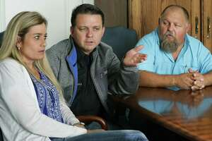 Cheryl Ramsey, left to right, her husband Gary Ramsey and Gary's brother Ronald Ramsey, gather in the law office of Maloney and Campolo to talk about the death of Gary and Ronald's mother Therese Ramsey Rodriguez who was killed in the Sutherland Springs shootings, on Wednesday, Nov. 29, 2017.