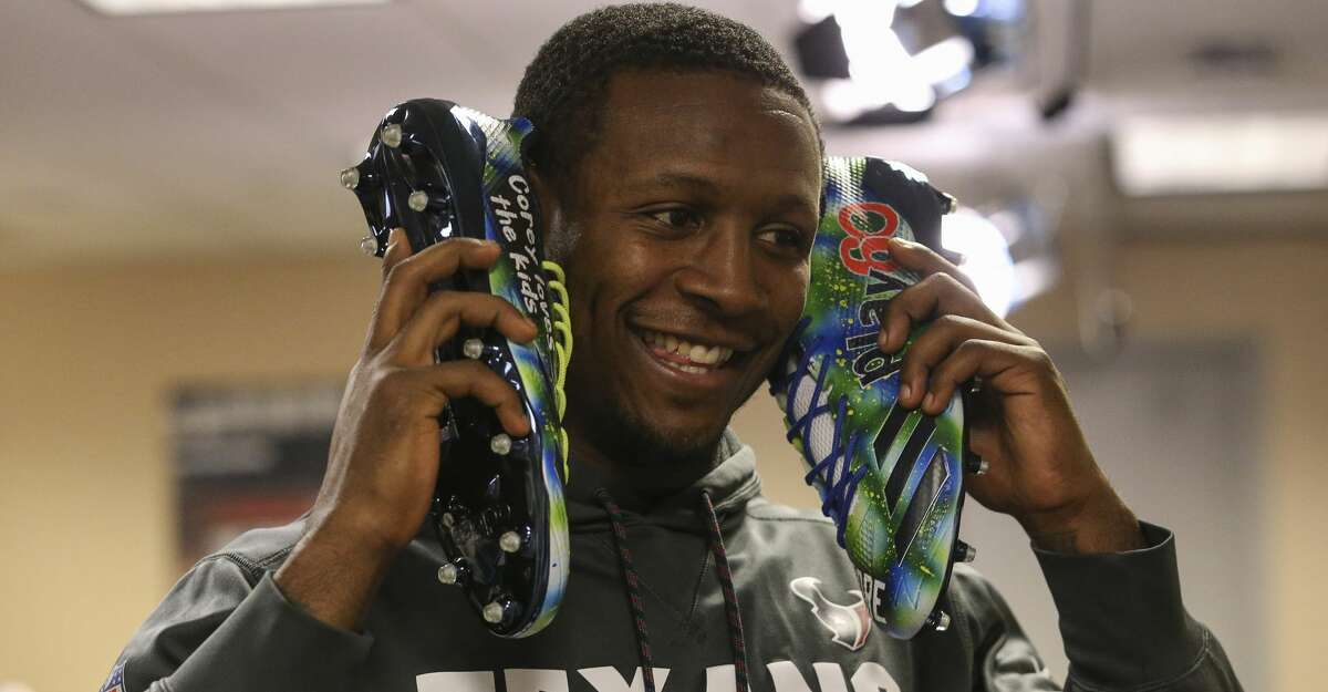 Houston Texans players look at their customized My Cause, My Cleats at NRG Stadium on Wednesday, Nov. 29, 2017, in Houston. ( Yi-Chin Lee / Houston Chronicle )