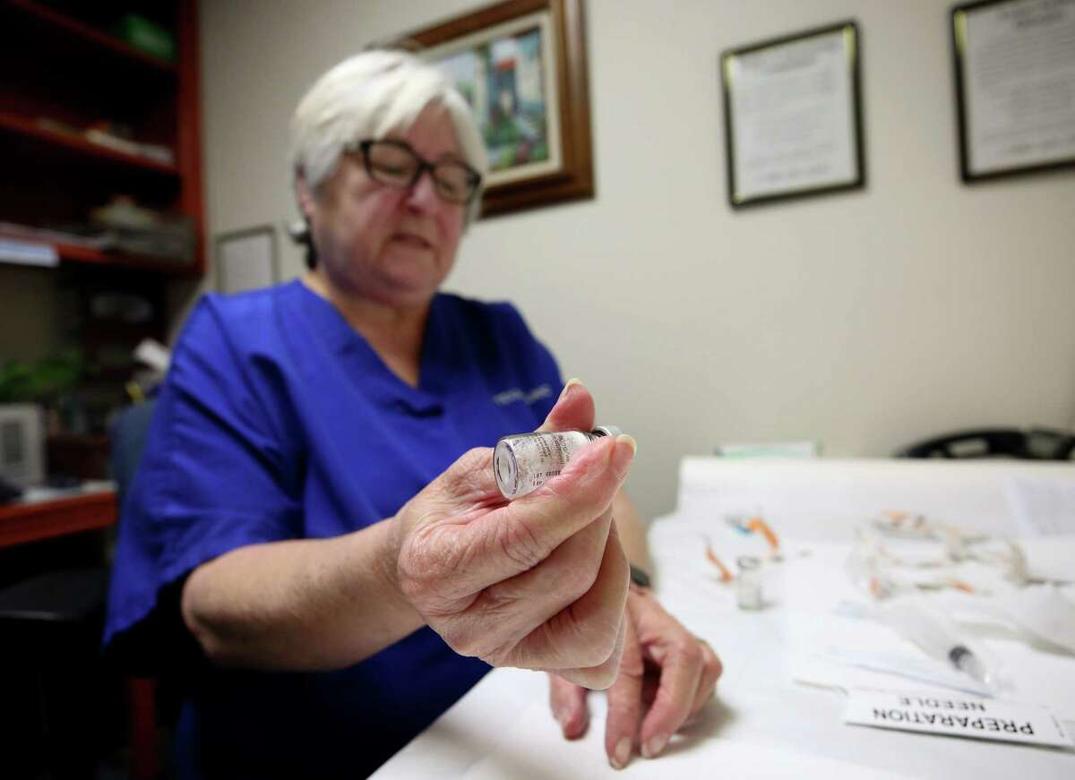 Texas Clinic nurse and drug counselor Gloria Rodriguez prepares a Vivitrol injection for a patient on Wednesday.