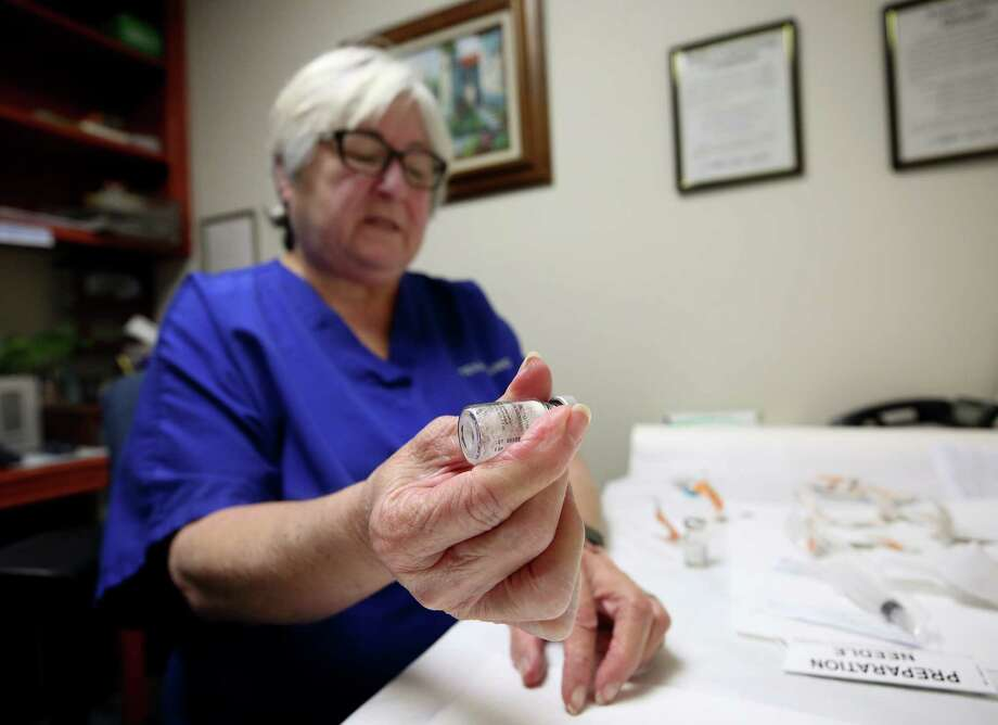 Texas Clinic nurse and drug counselor Gloria Rodriguez prepares a Vivitrol injection for a patient on Wednesday. Photo: Godofredo A. Vasquez, Houston Chronicle / Godofredo A. Vasquez