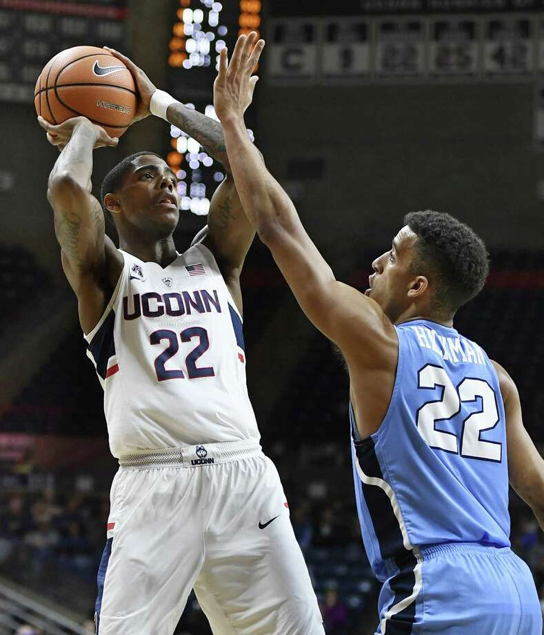 UConn's Terry Larrier, left, looks to shoot as Columbia's Nate Hickman defends in the first half of Wednesday night's game in Storrs. Photo: Jessica Hill / Associated Press / AP2017