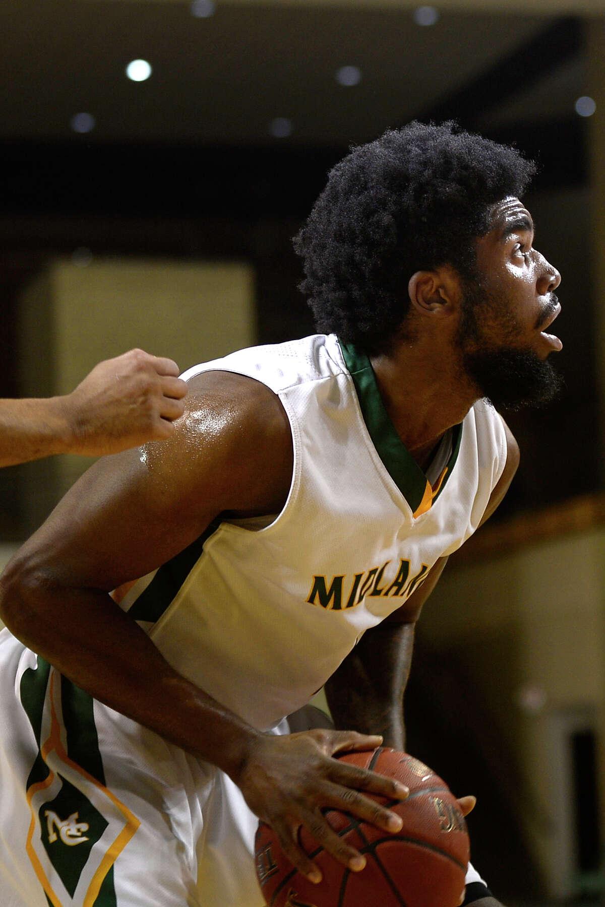 Midland College's Marquell Fraser (1) attempts a rebound against South Plains College on Nov. 29, 2017, at Chaparral Center. James Durbin/Reporter-Telegram