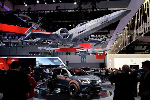 "Nissan vehicles are themed with various ""Star Wars"" characters and spacecraft at the Los Angeles Auto Show."