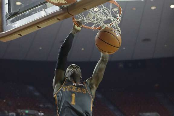 Texas guard Andrew Jones (1) scores over Florida A&M guard Marcus Barham (22) during the second half of an NCAA college basketball game, Wednesday, Nov. 29, 2017, in Austin, Texas. Texas won 82-58. (AP Photo/Eric Gay)