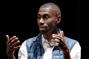 Civil rights activist DeRay Mckesson talks with Prof. Aabha Brown on the stage of the Cullen Performance Center at the University of Houston in Houston, TX, Nov. 29, 2017. (Michael Wyke / For the  Chronicle)