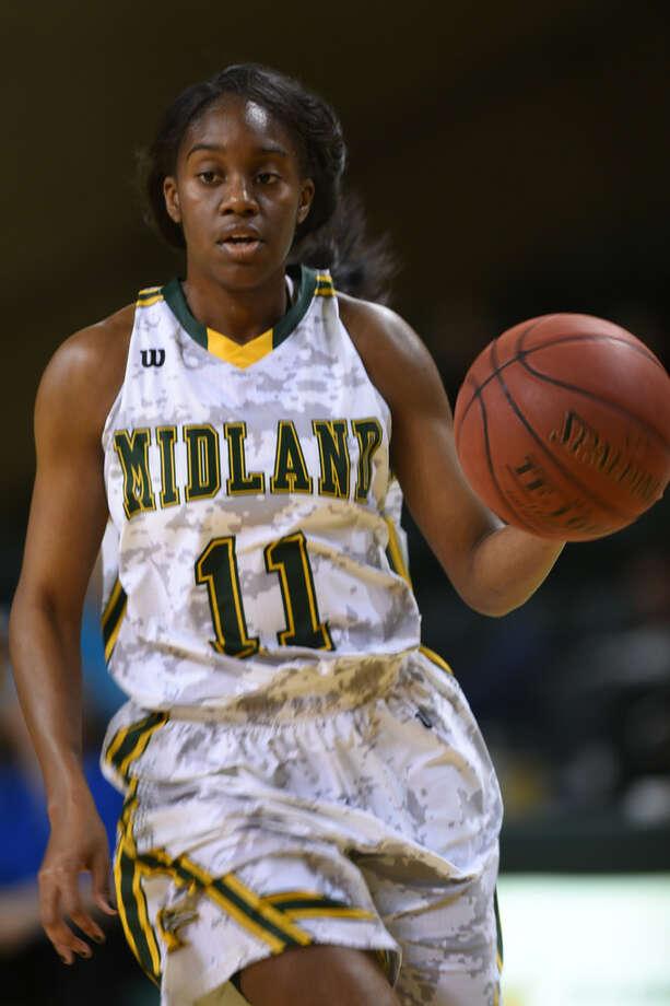 Midland College's Alexandrea Washington (11) dribbles against South Plains College on Nov. 29, 2017, at Chaparral Center. James Durbin/Reporter-Telegram