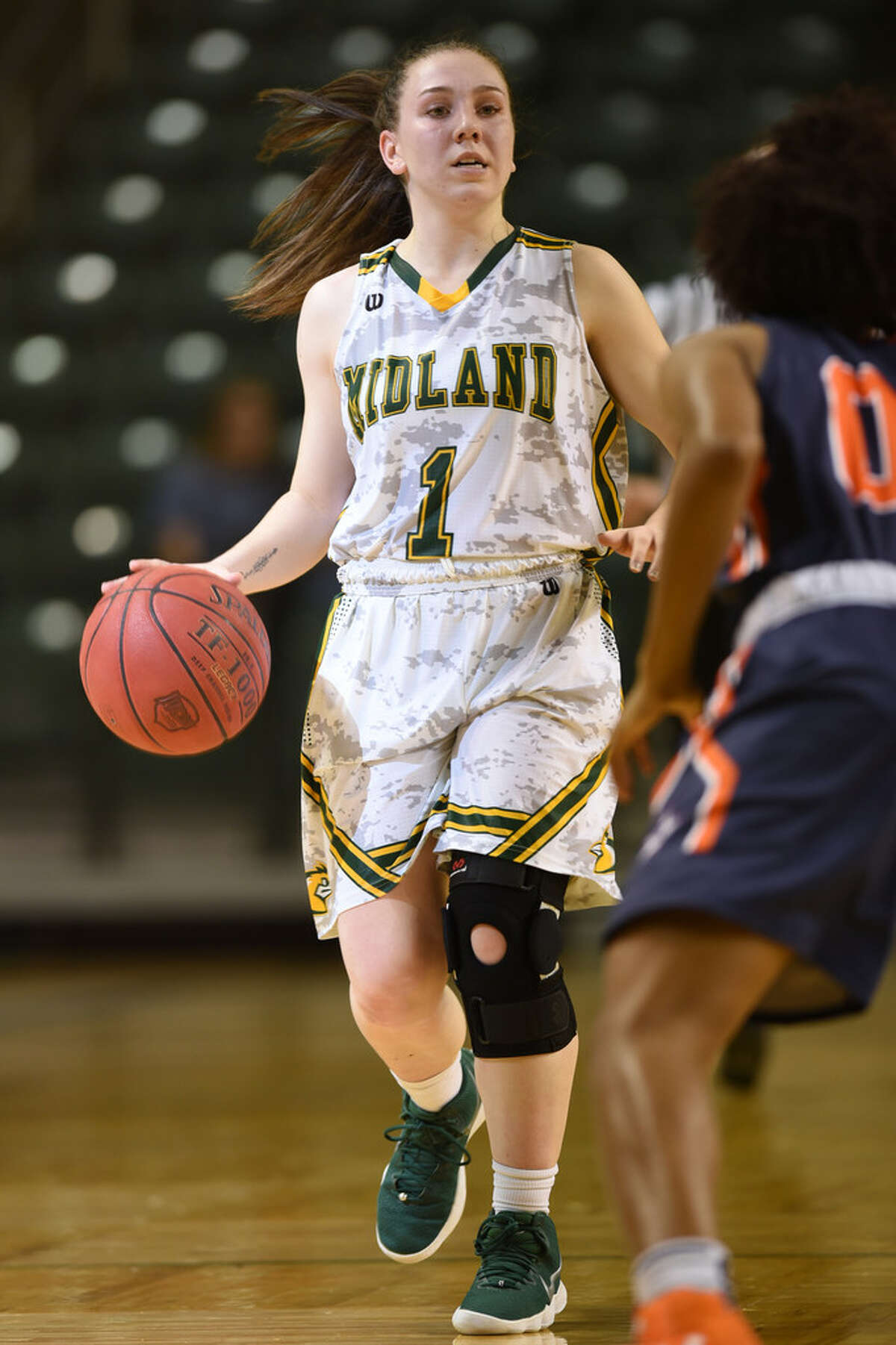 Midland College's Bethany Theodore (1) sets up a play against South Plains College on Nov. 29, 2017, at Chaparral Center. James Durbin/Reporter-Telegram