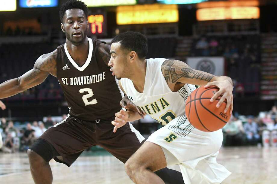 Siena's Roman Penn drives to the basket against St. Bonaventure's Matt Mabley during a basketball game at the Times Union Center on Wednesday Nov. 29, 2017 in Albany, N.Y. (Lori Van Buren / Times Union) Photo: Lori Van Buren / 20041655A