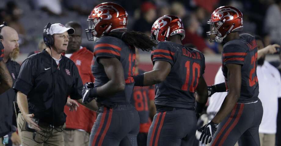 Houston Cougars head coach Major Applewhite greets defensive tackle Ed Oliver #10 on the sideline after a second quarter sack during the NCAA football game between the Memphis Tigers and the Houston Cougars at TDECU Stadium in Houston, TX on Thursday, October 19, 2017. Photo: Tim Warner/For The Chronicle