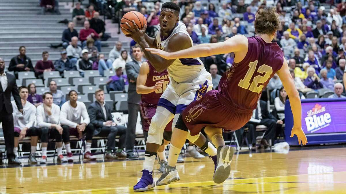 UAlbany's Travis Charles goes strong to the hoop as Colgate's Dana Batt tries to stop him during the first half of Wednesday night's game at SEFCU Arena. The Great Danes defeated the Raiders 75-69. (Bill Ziskin / UAlbany Athletics)