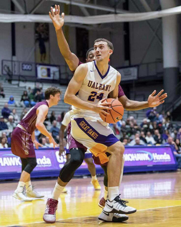 UAlbany's Joe Cremo posts up a Colgate defender during the second half of Wednesday night's game at SEFCU Arena. The Great Danes defeated the Raiders 75-69. (Bill Ziskin / UAlbany Athletics) Photo: Bill Ziskin / (c) Bill Ziskin Photography LLC