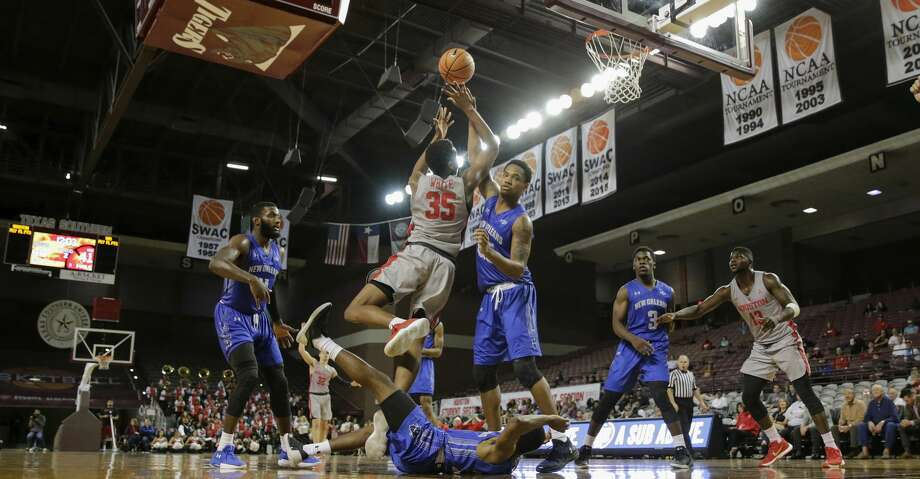 Houston Cougars forward Fabian White Jr. (35) goes up for a shot and draws a foul by New Orleans Privateers forward Travin Thibodeaux (25) in the second half during the NCAA basketball game between the New Orleans Privateers and the Houston Cougars at HP&E Arena in Houston, TX on Wednesday, November 29, 2017. Photo: Tim Warner/For The Chronicle