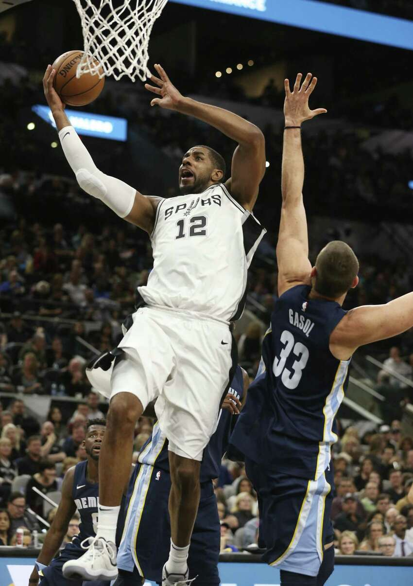 San Antonio Spurs?' LaMarcus Aldridge gets by Memphis Grizzlies?' Marc Gasol for two during the first half at the AT&T Center, Wednesday, Nov. 29, 2017.